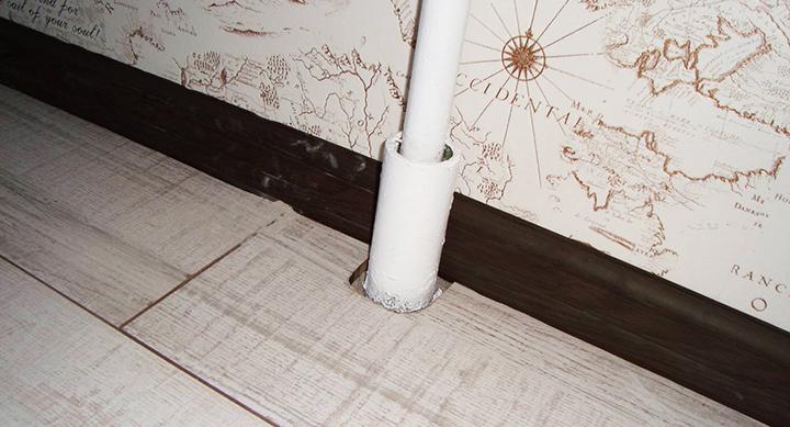 Зазоры в ламинате вокруг труб отопления